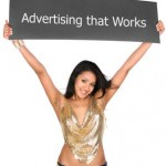 Picture of a girl holding a sign that reads &quot;advertising that works&quot;